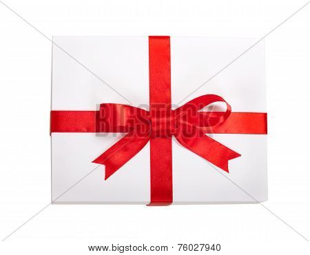 Gift Box With Red Ribbon And Teg