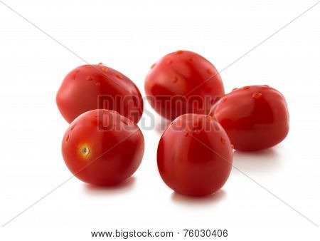 Five Strawberry Shaped Tomatoes On White Background