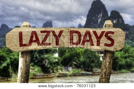 Lazy Days sign with a forest background