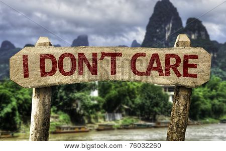 I Don't Care sign with a forest background