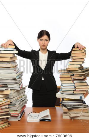 Girl And Two Large Piles Of Books