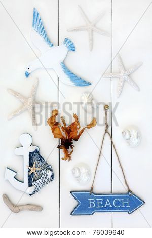 Abstract of seaside symbols with beach sign over wooden white background. poster
