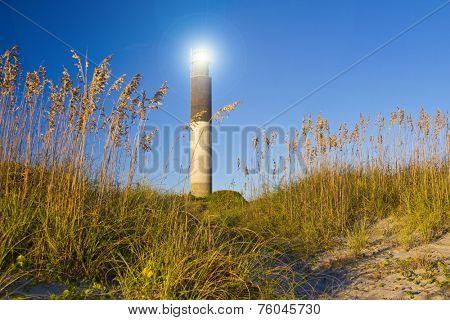 Oak Island Southport North Carolina Lighthouse through the Casswell Beach seagrass at sunset