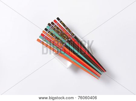 set of colorful chopsticks on white background