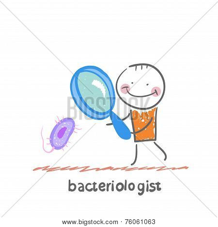 bacteriologist looks through a magnifying glass on microbes