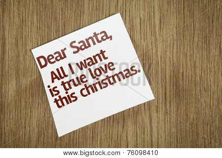 Dear Santa, All I Want is True Love This Christmas on Paper Note on texture background