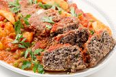 Homemade meatloaf baked in tomato sauce with peas and potatoes on a dish poster