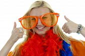 portrait of Dutch soccer fan in orange outfit with big glasses and thumbs up over white background poster