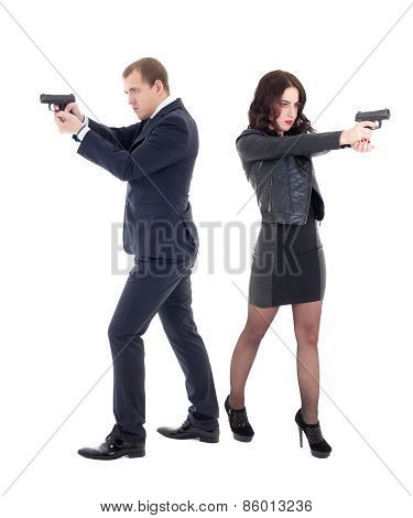 Full Length Portrait Of Woman And Man Shooting With Guns Isolated On White