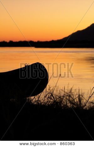 Canoe on riverbank
