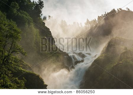 Mountain creek cascade with fresh green moss on the stones, with the spray of droplets poster