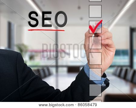 businessman checking mark on checklist marker. Checking SEO. Isolated on background, Stock Phot
