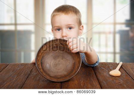 Cute Blonde Boy Shows Empty Plate