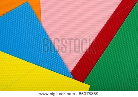 Pink, blue yellow, green paper corrugated cardboard. poster