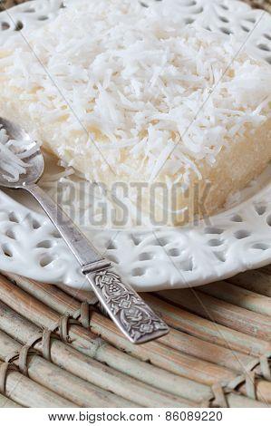 Close Up Of Brazilian  Dessert Sweet Couscous Pudding (cuscuz Doce)
