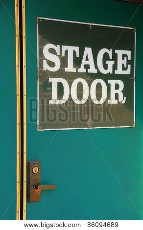 Old green metal doors with stage entrance