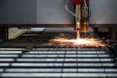 Industrial cnc plasma cutting of metal plate poster