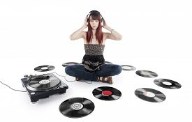 Serious Woman Listening Music on a Vinyl Turntable