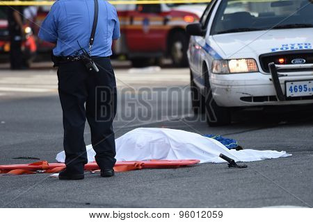 NYPD officer stands over body