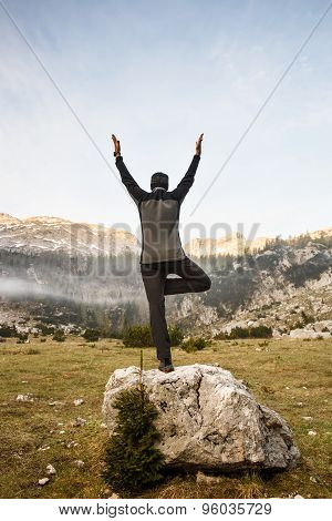 Man Practicing Yoga, Performing A Tree Pose
