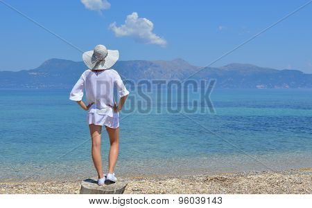 Young Woman Looking At The Mountains Above Sea
