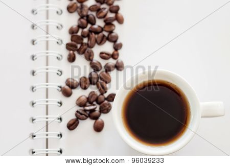 Top View Of Cup Of Fresh Espresso On Notebook