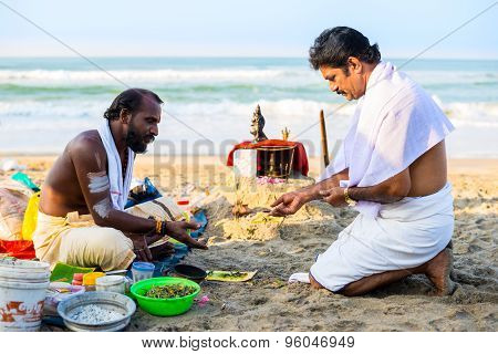 Varkala, India - February 22, 2013: Hindu Brahmin With Religious Attributes Providing Ceremony And A