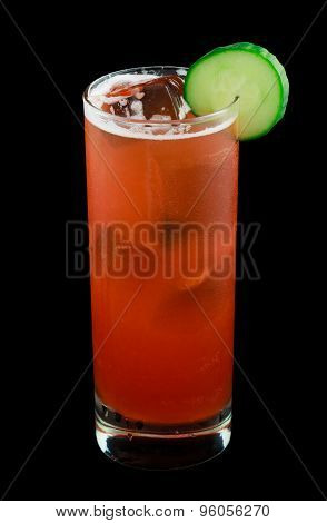 Red drink with a cucumber slice isolated on black
