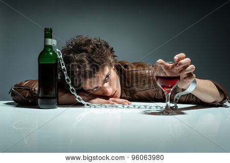 Drunk Man Sleeping At The Table With A Glass Of Wine