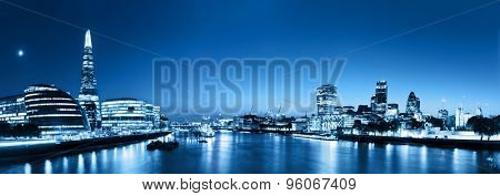 London skyline panorama at night, England the UK in lights. Tower of London, The Shard, City Hall, River Thames. Seen from Tower Bridge