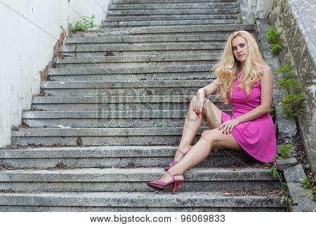 Woman Sitting On The Stairs