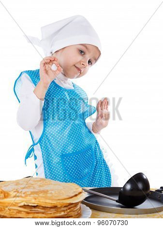 Little Kid Cooking Pancakes. Girl Gesturing Good Or Delicious. Isolated On A White Background.