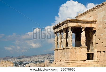 Caryatids Portico On Acropolis And Athens View.