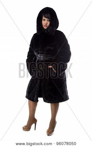 Photo of pudgy brunette in black coat