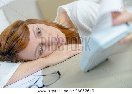 Sad lady slouched on table