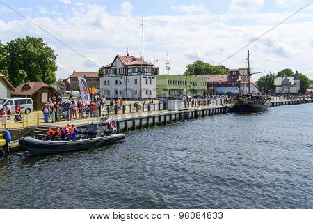 USTKA - JULY 08: View of the river Slupia with promenade and marina on 8 July 2015 in Ustka, Poland.