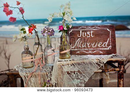 It is written on label word love flowers ocean water bottle