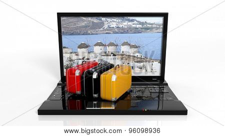 Suitcases on black laptop keyboard with Greek island on screen, isolated
