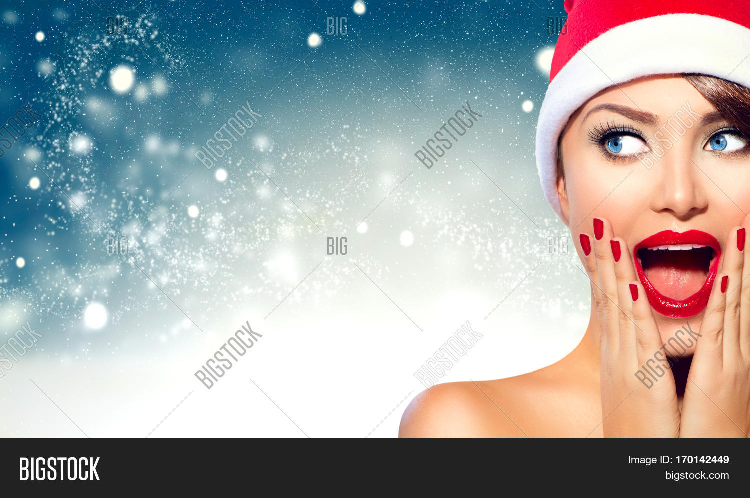 0a0f7c877e549 Christmas woman. Beauty model girl in Santa Claus hat with red lips and  matching manicure