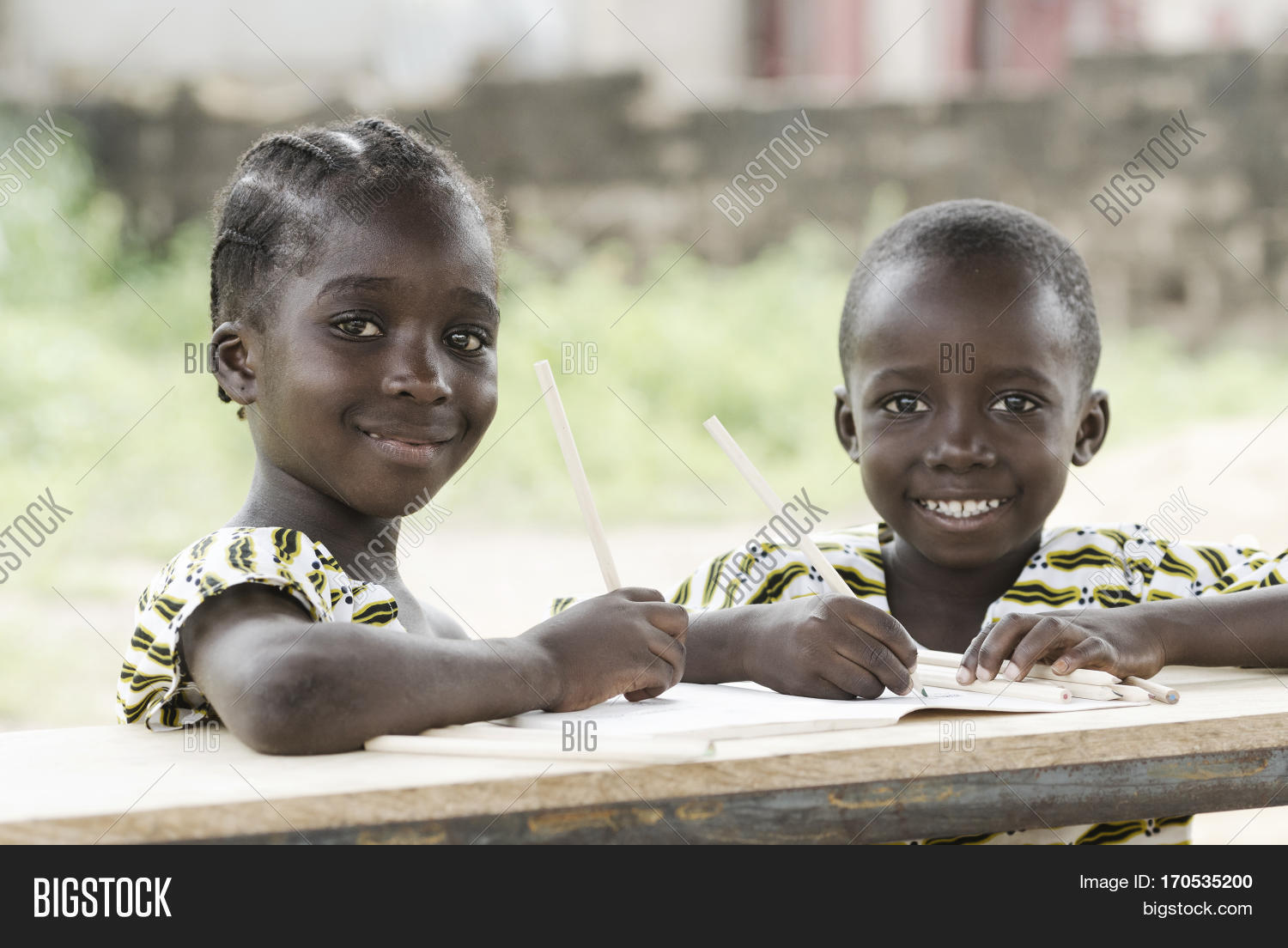 Two african children smiling and studying in school in bamako mali