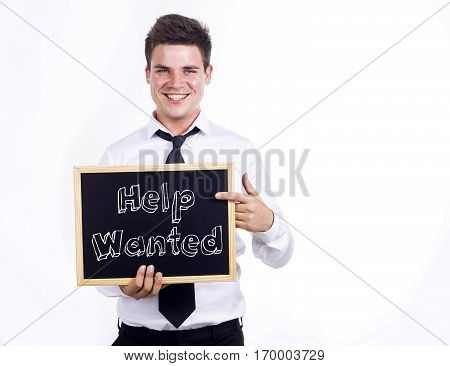 Help Wanted - Young Smiling Businessman Holding Chalkboard With Text