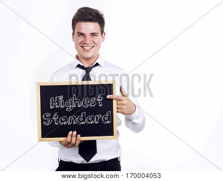 Highest Standard - Young Smiling Businessman Holding Chalkboard With Text