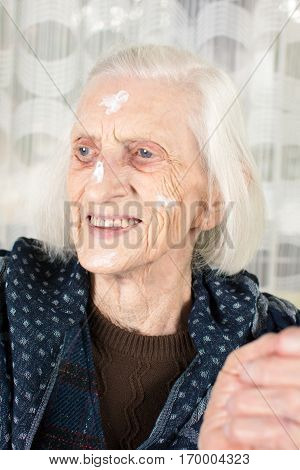 Grandma With Face Cream Close Up