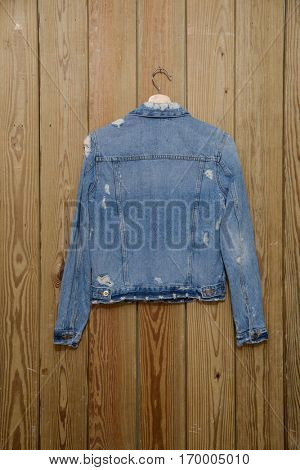 Back jeans jacket â??wooden background