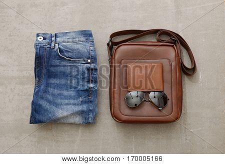 Men's fashion accessories on gray grunge background