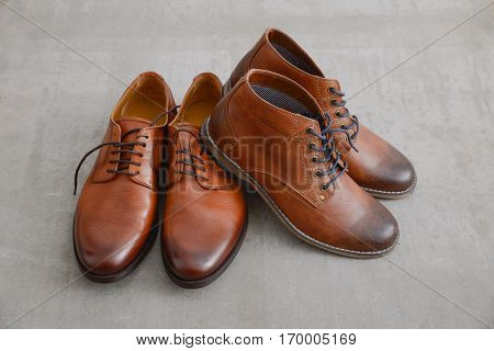 Fashionable men's shoes-Expensive shoes autumn brown on gray background.