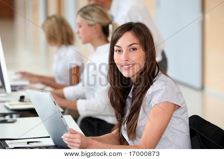 Businesswoman working in the office on electronic pad