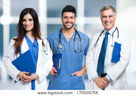 Group of smiling doctors. Bright blurred background.