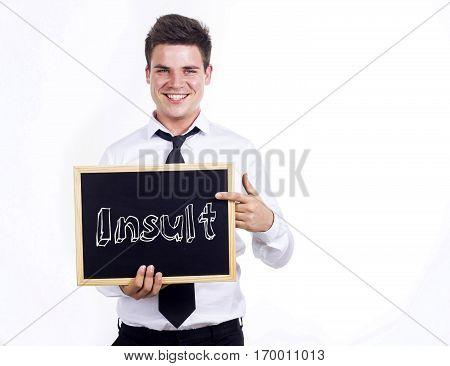 Insult - Young Smiling Businessman Holding Chalkboard With Text