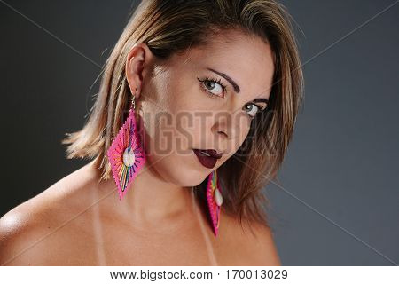 Close Up Portrait Of Beautiful Woman Wearing Cowrie Shell Earrings